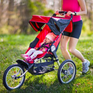Woman pushing buggy